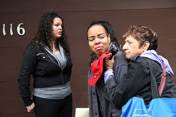 Resident Julissa Hernandez (C) is comforted any her friend Raquel Andreatto (R) after Hernandez' unit on San Jose Avenue suffered a fire. Photo by Lou Dematteis