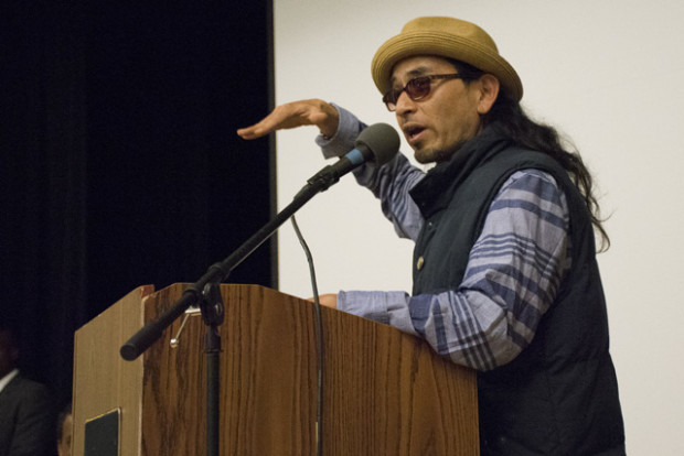 File photo: Ilyich Sato, also known as the rapper Equipto, speaks at a community meeting about police shootings. Photo by Lola M. Chavez