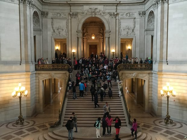 The protesters amassed on the interior steps of city hall. Photo by Joe Rivano Barros.