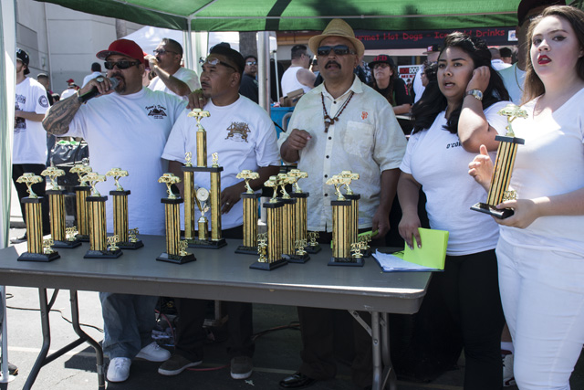 Presentation of trophys at the lowrider show at John O'Connell High School. Photo by Lola M. Chavez