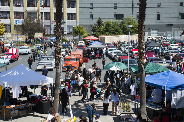 The car show at John O'Connell where the lowriders came to the hunger strike from. Photo by Lola M. Chavez
