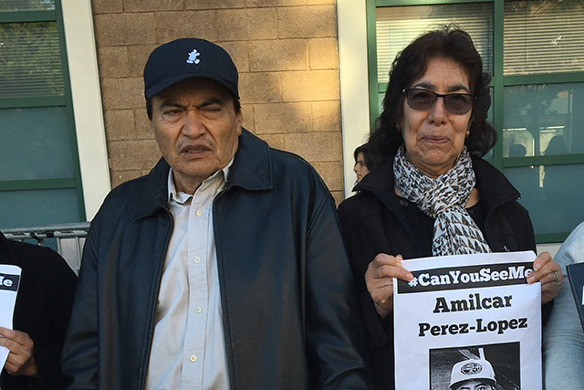 Refugio and Elvira Nieto, the parents of 2014 police shooting victim Alex Nieto, stand at a vigil for Amilcar Perez Lopez in front of Mission Station. Photo by Laura Wenus