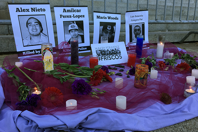 A small altar honoring victims of police shootings and the hunger strikers known as the Frisco Five set up in front of City Hall. Photo by Laura Wenus