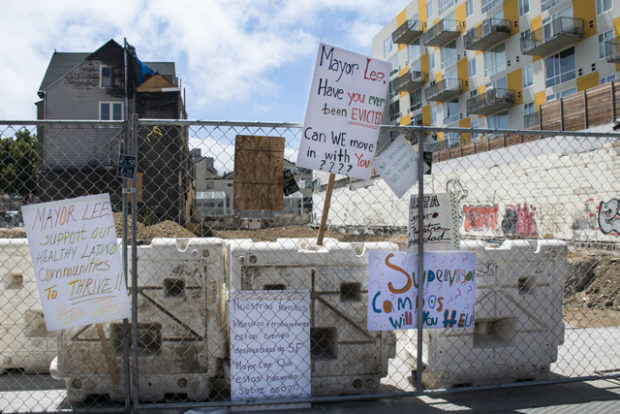 Signs left at the site of the Mission and 22nd fire after the rally on Wednesday, June 22.  Photo by Lola M. Chavez