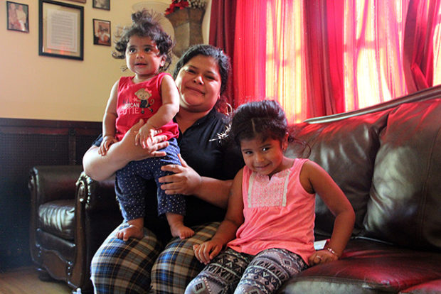 Karen and her two daughters at the Mission shelter for families. Photo by Laura Wenus