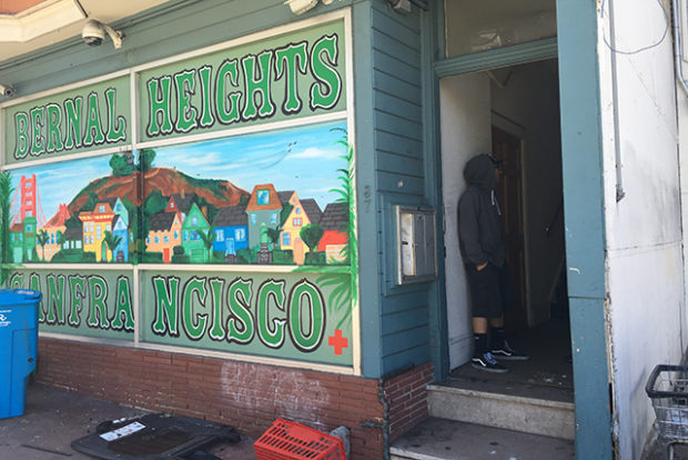 Some of the 58 tenants displaced by a fire at 29th and Mission Streets entered their buildings for the first time on June 20. Photo by Laura Waxmann