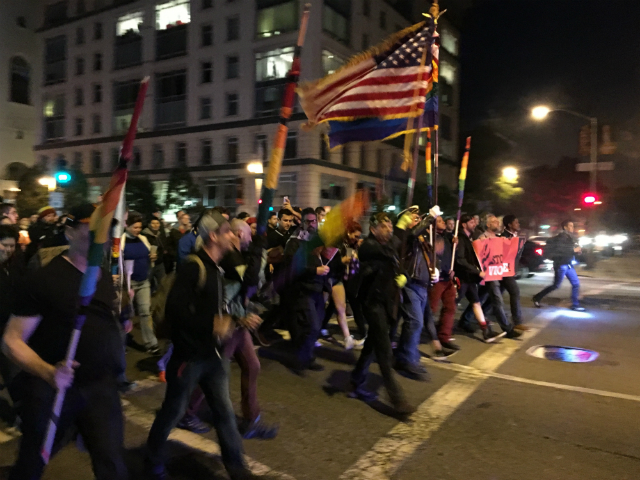 Flag bearers lead the march to City Hall after a vigil in the Castro for the shooting victims in Orlando. Photo by Joe Rivano Barros.
