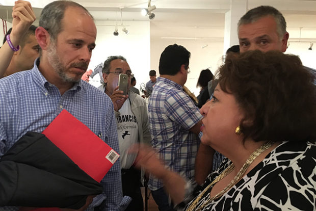 Sylvia Alvarez-Lynch talks as SFMTA Director Ed Reiskin listens.