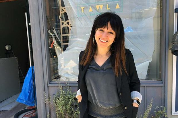 Azhar Hashem stands in front of her first Mediterranean restaurant, Tawla, set to open at 206 Valencia St. in early June. Photo by Laura Waxmann