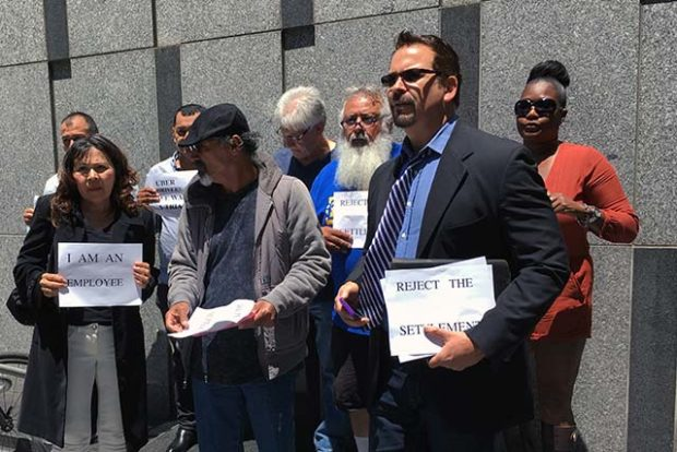 Uber driver Edward Escobar (right) heads the newly formed Alliance for Independent Workers, a group of on-demand drivers organizing against Uber.  Photo by Laura Waxmann