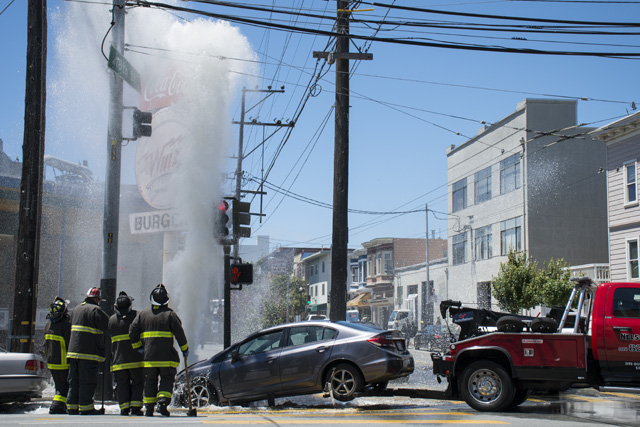Intersection Flooded After Car Rams Fire Hydrant Following a Collision