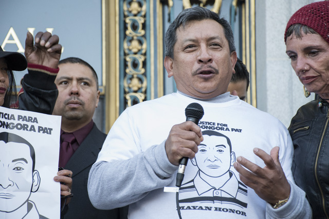 Luis Poot Pat addresses protesters on the steps of City Hall. Photo by Lola M. Chavez