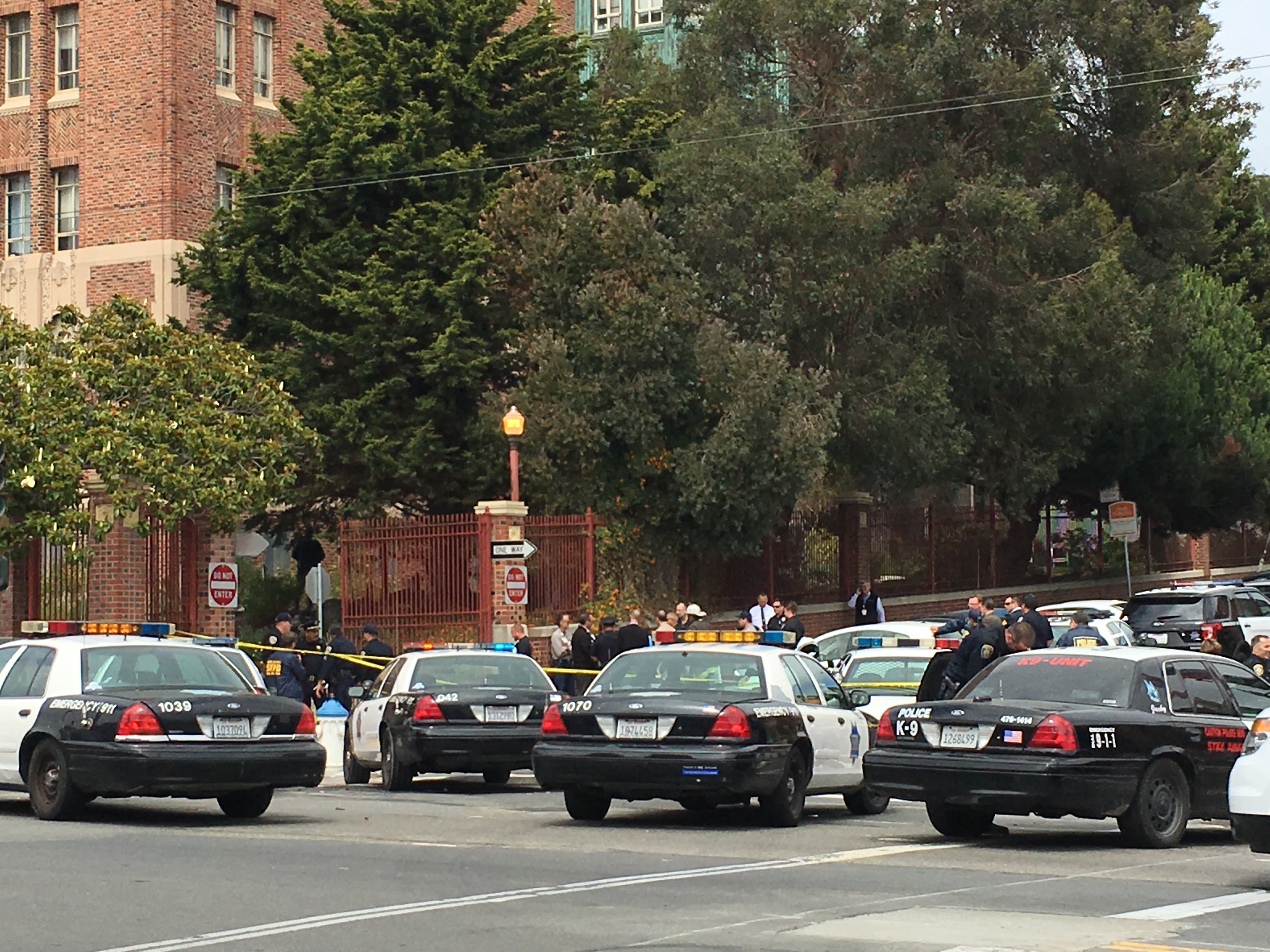 Squad cars assembled on 22nd Street and Potrero Avenue as officers conduct a search of the San Francisco General Hospital building where a firecracker was set off on July 7, 2016. Photo by Joe Rivano Barros.