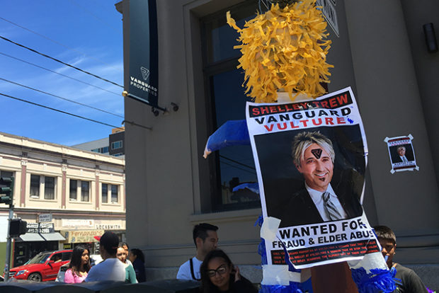 Protesters taped posters with real estate agent Shelley Trew's image on buildings along Mission Street. Photo by Laura Waxmann