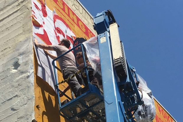 Shepard Fairey's new mural   at 701 Alabama St. is in progress. Photo by Laura Waxmann