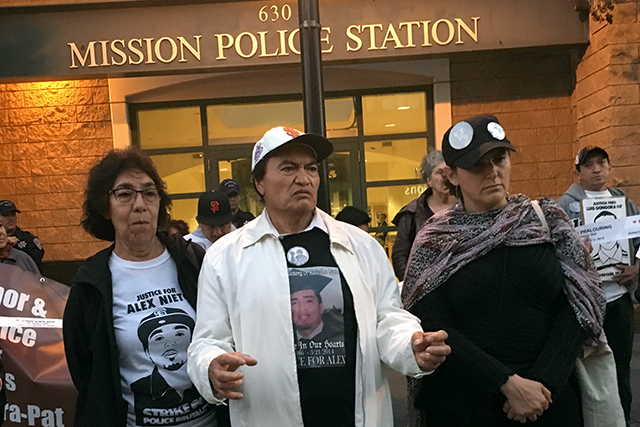 Elvira and Refugio Nieto (left and center), address protesters marching for justice in recent police killings. Their son, Alex, was shot and killed by officer on Bernal Hill in 2014. Photo by Laura Waxmann