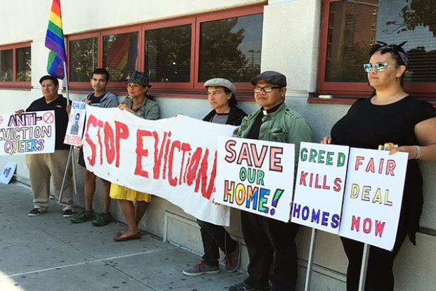 Members of the Holly Park Collective and their supporters gathered at John O'Connell High School on August 11 to protest the sale of their Bernal Heights home. Photo by Laura Waxmann