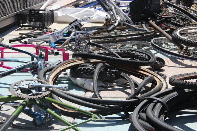 "Some of the bike parts confiscated on August 15, 2016, during a police crackdown on a ""chop shop."" Photo by Joe Rivano Barros."