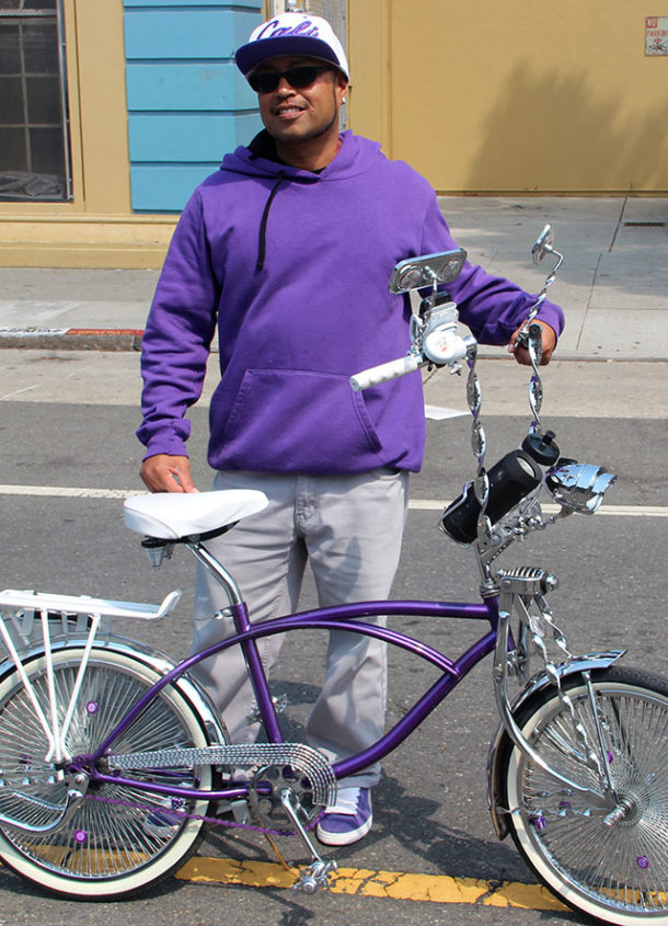 "Keyd, perfectly color-coordinated with his low rider bike, is part of the Slow Rydaz. ""Since I was born I've been around low rider culture. It's helped me stay positive."""