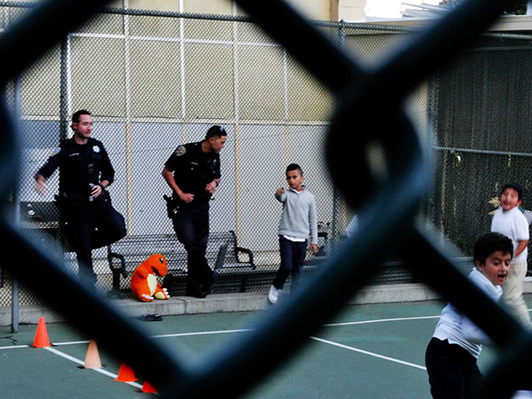 Officers referee a dodgeball match. Photo by Sonner Kehrt