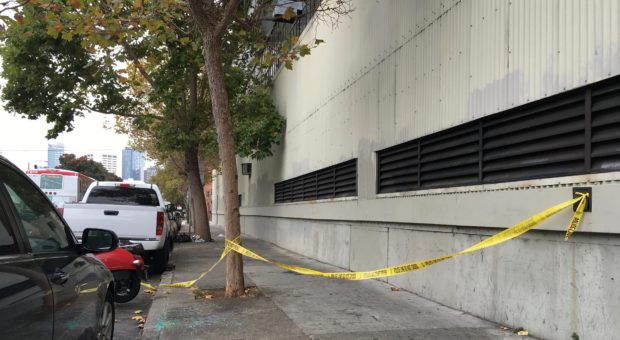 Folsom Street between 15th and 16th streets on Friday morning, hours after a man had been found dead by homeless residents. Photo by Joe Rivano Barros.