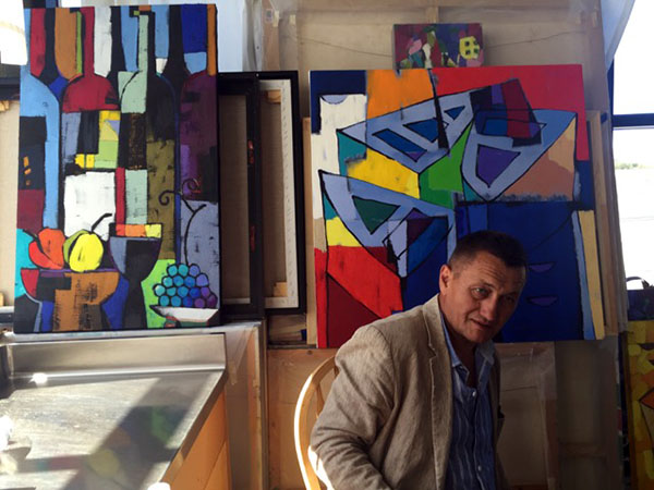 Vadim Puyandaev with his paintings.