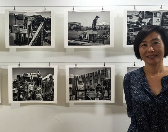 Yon Sim with her photographs.