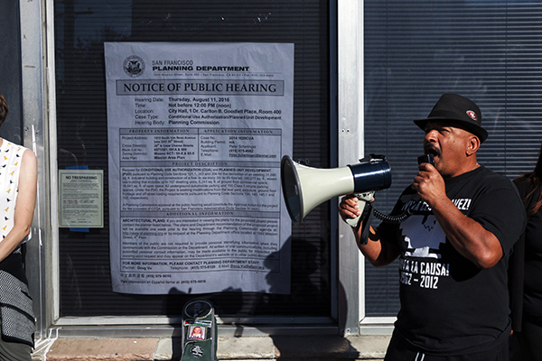 Robert Hernandez speaking to the protesters. Photo by Serginho Roosblad