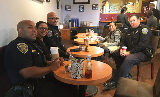 Officers chat with each other and L's Caffe customers during National Coffee with a Cop Day. Photo by Spencer Silva