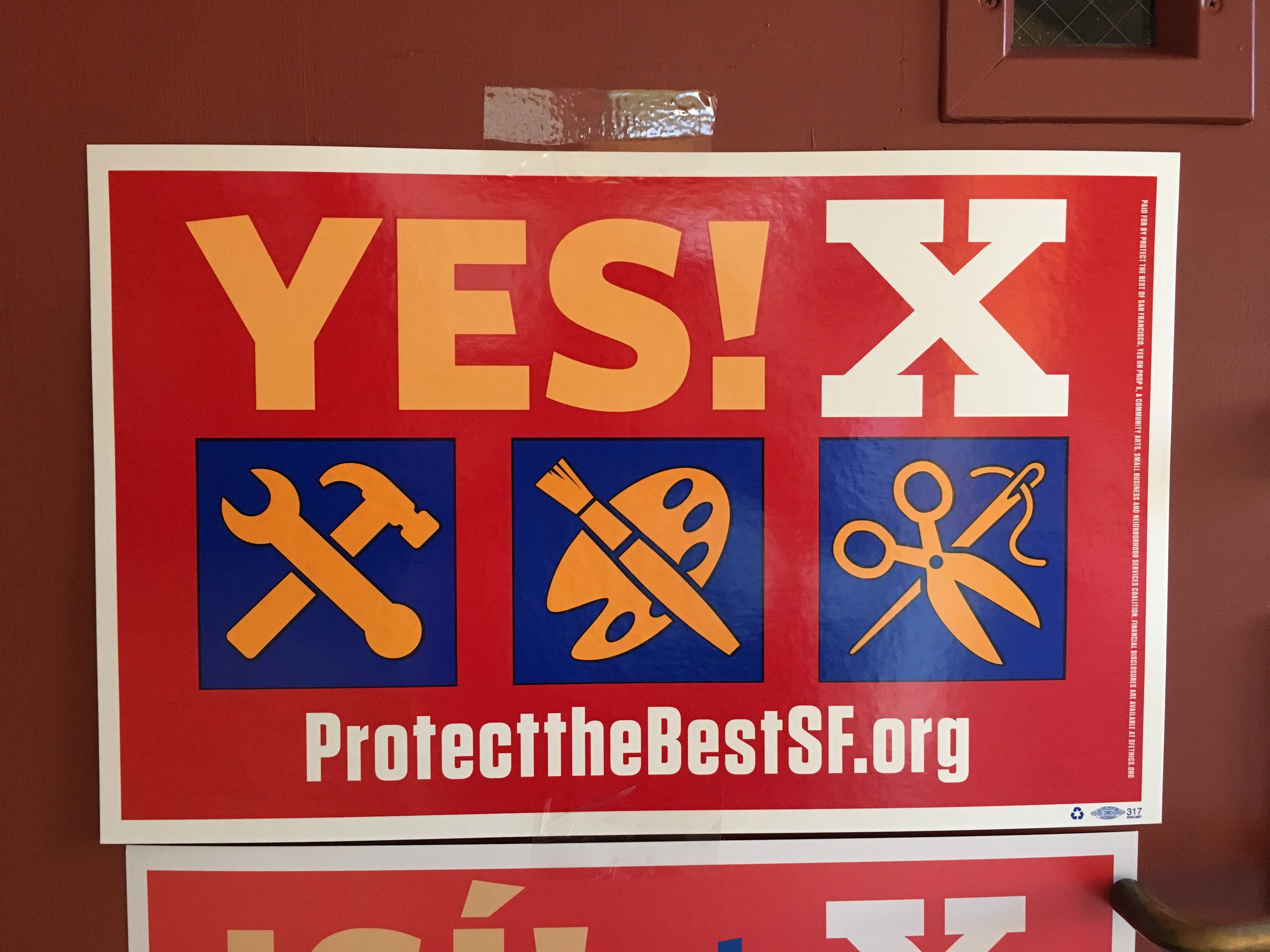 "A ""Yes on X"" sign at the Mission Cultural Center. Photo by Joe Rivano Barros."