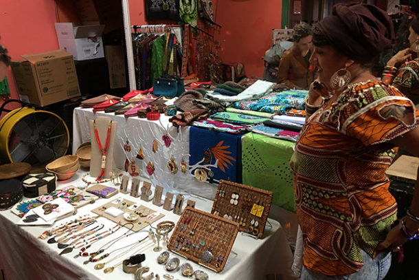 Eva Miranda talks to a customer inside Bissap Baobab.