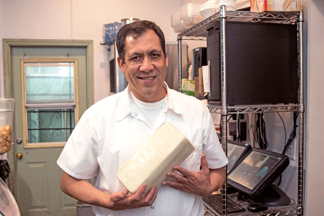 Esteban Lopez with block Mozzarella cheese. Only Block cheese is used.