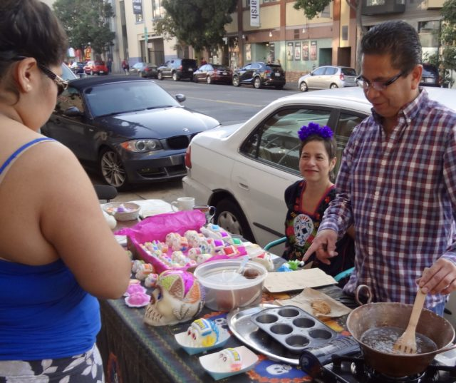 Mexican Artist Miguel Quintana (right) and Casa Bonampak store owner Nancy Charraga on Valencia Street Tuesday.