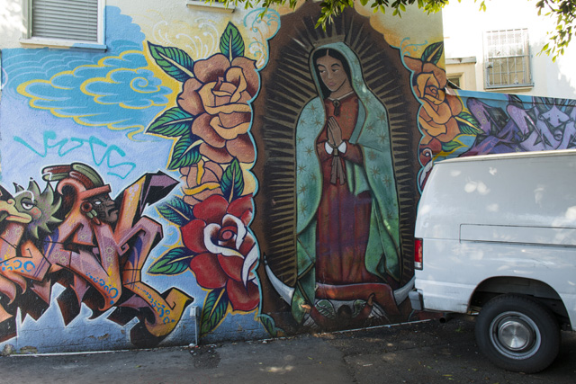 A mural at the parking lot at 24th and Capp streets. Photo by Lola M. Chavez