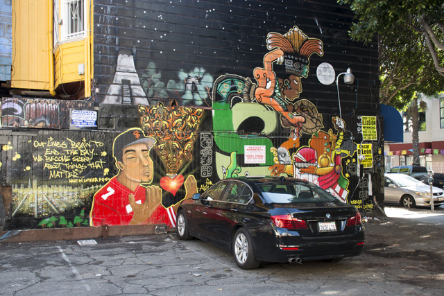 Murals at the parking lot at 24th and Capp streets. Photo by Lola M. Chavez