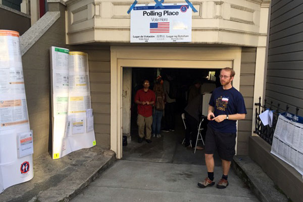 Jeremy, a poll worker outside a station on Alabama Street. Photo by Lydia Chávez