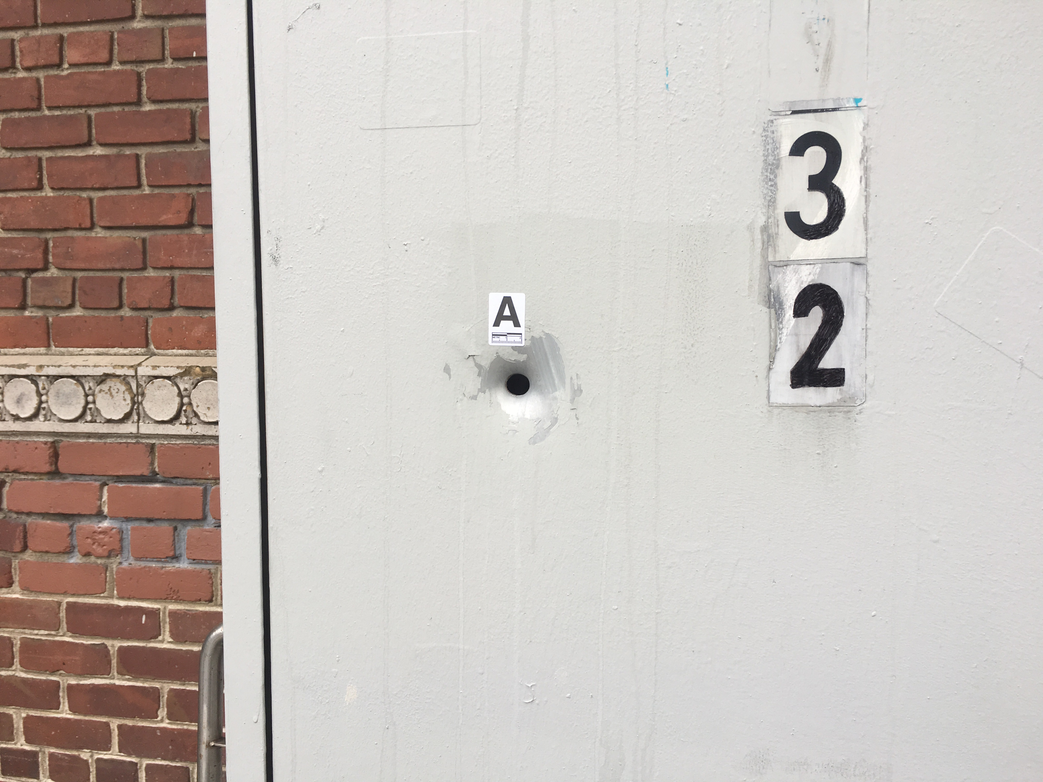A bullet hole in a utility box at the scene of a shooting at 25th and Vermont streets on Wednesday, November 30, 2016. Photo by Joe Rivano Barros.
