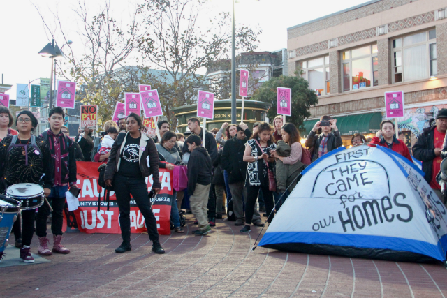 Protesters at the 24th Street BART Station on November 3, 2016, rallying against housing propositions. Photo by Joe Rivano Barros.