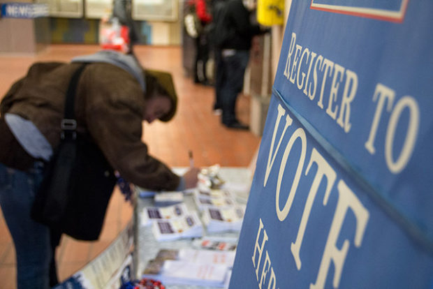 File photo: Voters register at 16th Street BART station in 2012