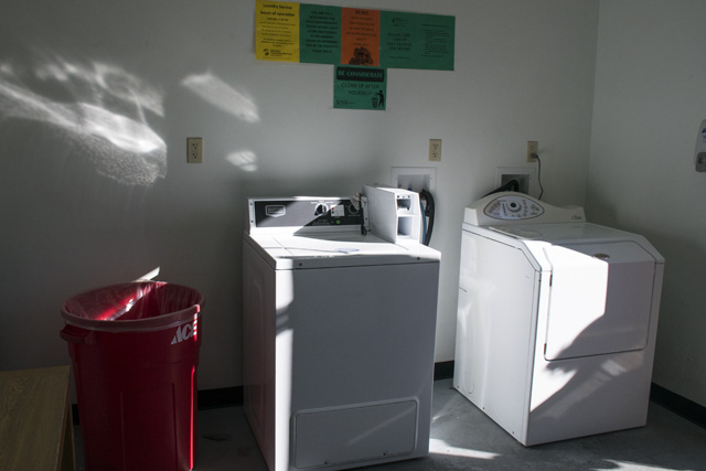 Navigation Center laundry room. Photo by Lola M. Chavez