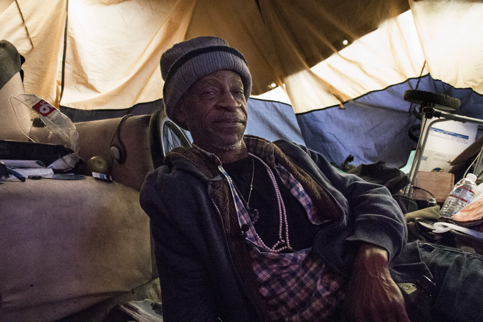 Amos Lee Howard in his tent. Photo by Lola M. Chavez