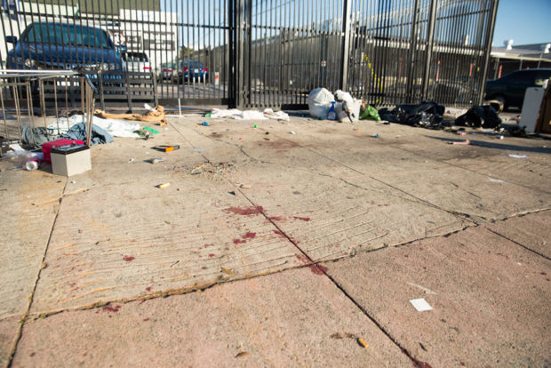 Dried bloodstains on the sidewalk near a double homicide at the tent encampment on 16th and Shotwell streets. Photo by Brian Rinker
