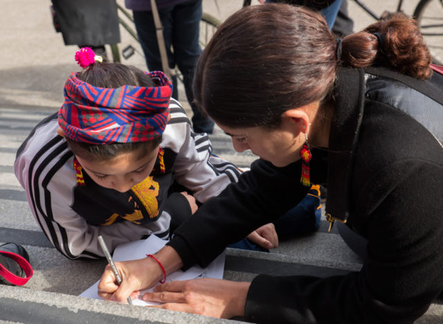 During a press conference at City Hall on Monday, Lorena Melgarejo helped her daughter, Ixchel Quezada, write a letter to Mayor Ed Lee asking him to protect undocumented immigrants.