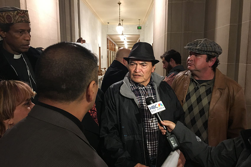 Refugio Nieto, Alex Nieto's father, being interviewed after the meeting. Photo by Laura Wenus