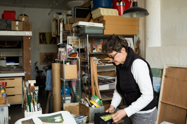 Debra Walker in her art studio at Developing Environments. She lives in the adjoining unit. Photo by Brian Rinker.