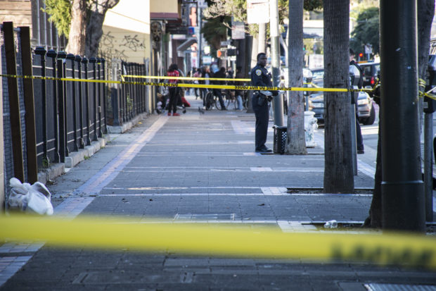 Half the Mission block between 16th and 15th streets was taped off because of blood trails. Photo by Lola M. Chavez