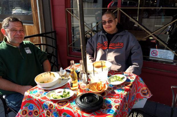 Jone and Ruben enjoying a Sunday bowl of menudo at Puerto Alegre on Valencia Street. Photo by Lydia Chávez