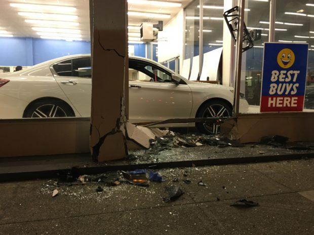 A Zipcar drove through the window of a San Francisco Honda dealership at 16th Street and South Van Ness Avenue on January 15, 2017. Photo by Joe Rivano Barros.