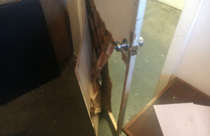 One of the internal doors at Adobe Books smashed during a robbery on January 16, 2017. Photo courtesy of Brett Lockspeiser.