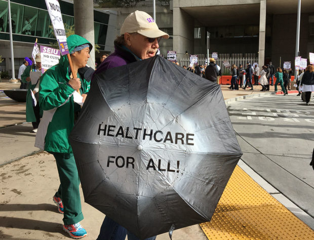 A protester at SF General Hospital. Photo by Laura Wenus